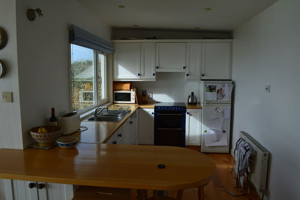open-plan kitchen, with breakfast bar