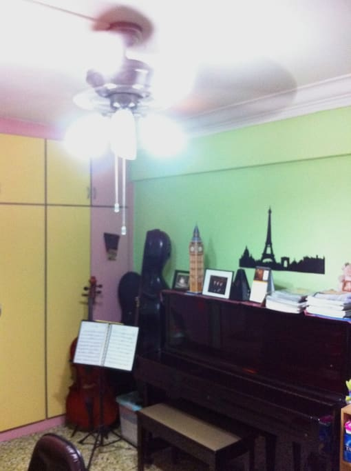 Ceiling fan to keep you cool in warm Singapore :) And a piano for use if you like