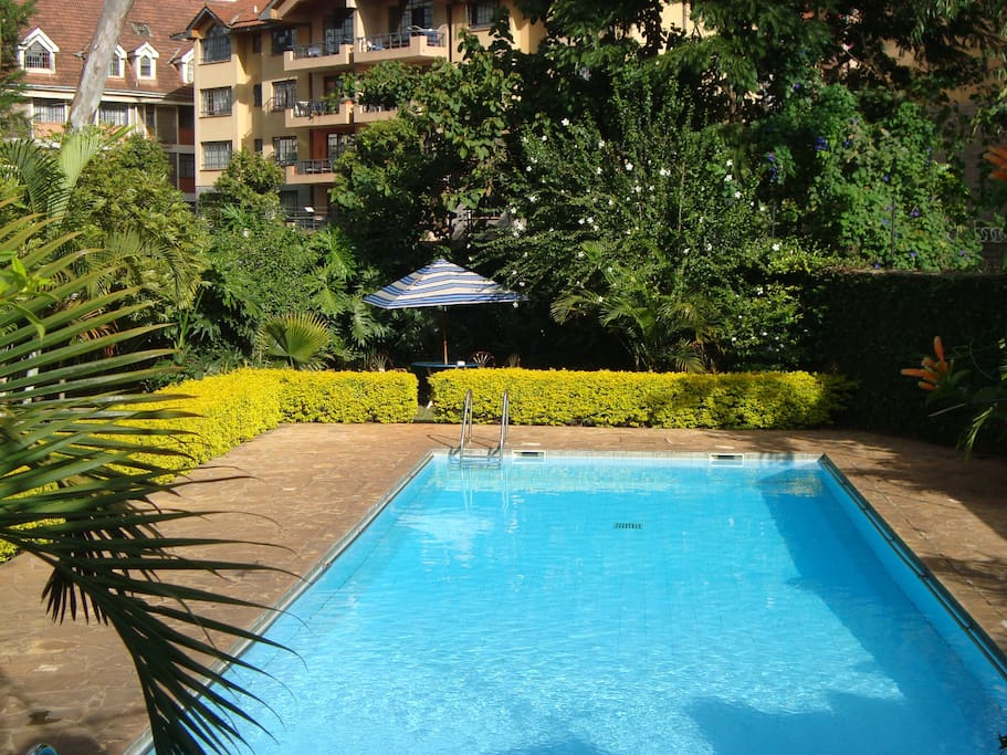 Landscaped pool with all day sun and great gym next door