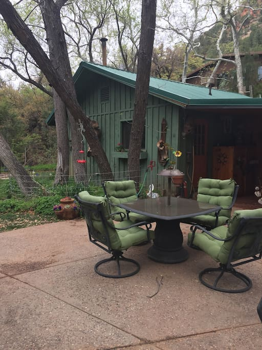 Outside patio for relaxing under the canopy of trees