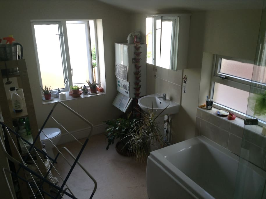 Access to heating controls, a place to dry your washing, a shelf all to yourself, a mirror with light and a shaver socket