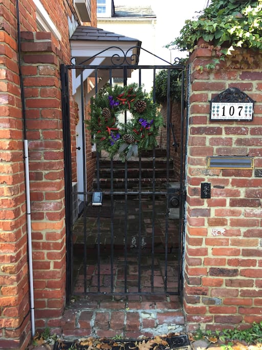 Gated entrance to the carriage house.