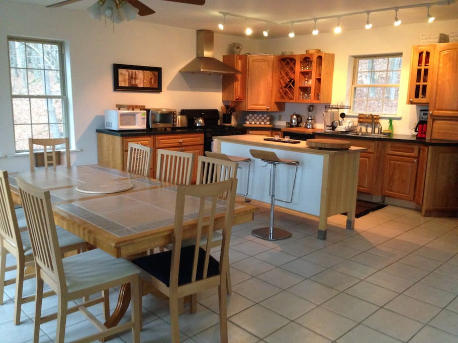 Large, well equipped dine in kitchen with seating for eight.