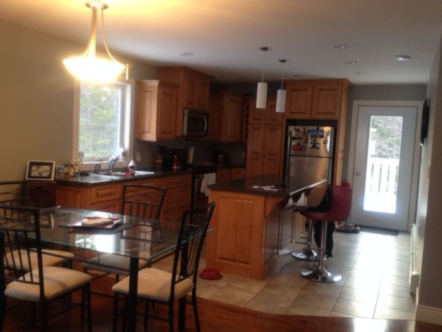 Kitch with large island and access to beautifu back patio.