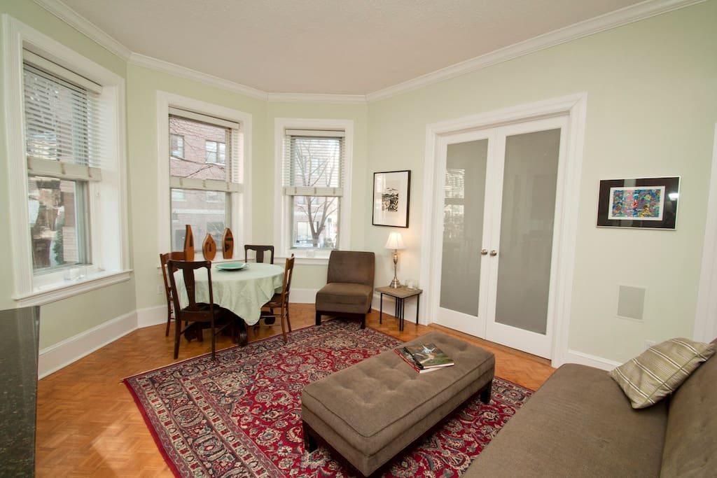 Living and dining area with the two large doors that opening into the bedroom.