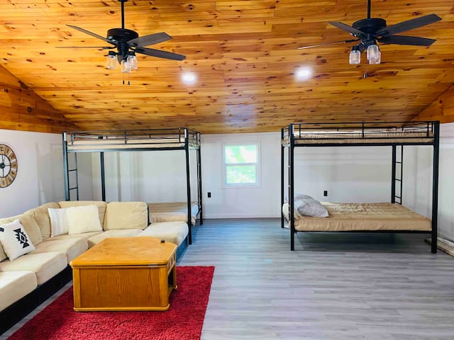 Bunks, hang out space, ceiling fans, TV, DVD player.