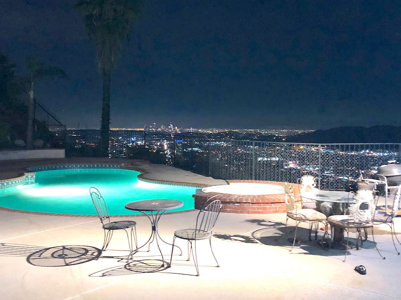 Night city view with the swimming pool
