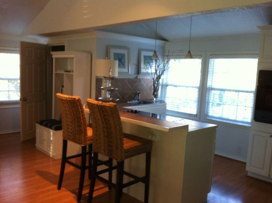 Cottage kitchen with full refrigerator, 4 burner stove, coffee maker and teapot, fully stocked kitchen, storage/ clothing closet