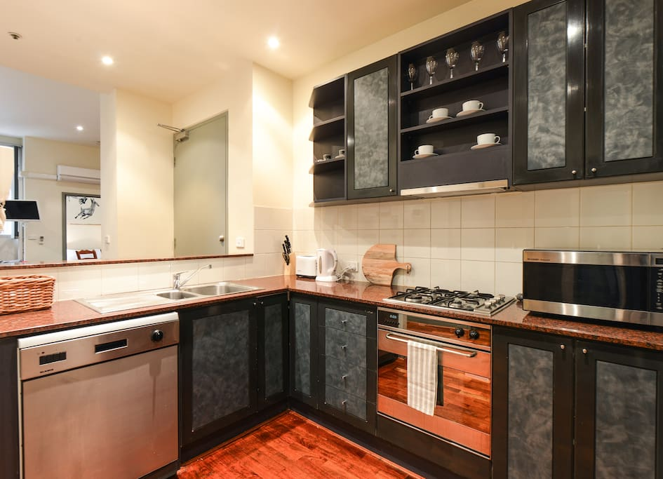Fully equipped kitchen includes tea, coffee, salt, pepper, cooking oil.