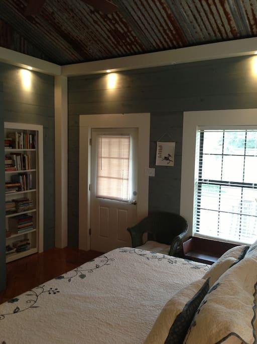 King bedroom with hidden door into shared library