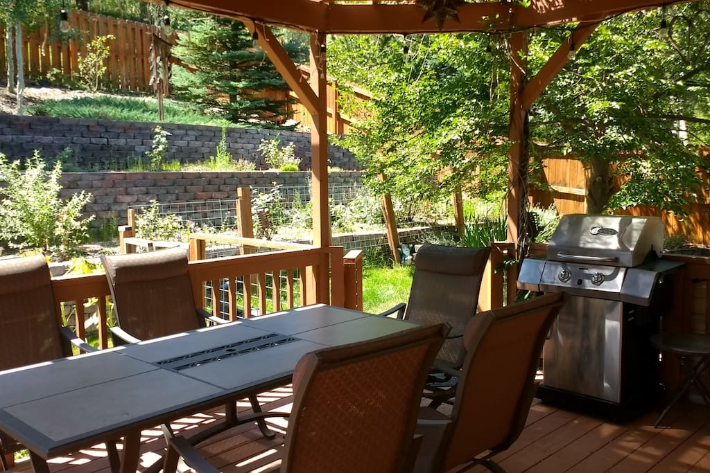 Shaded outdoor deck with seating for 10 and a propane grill
