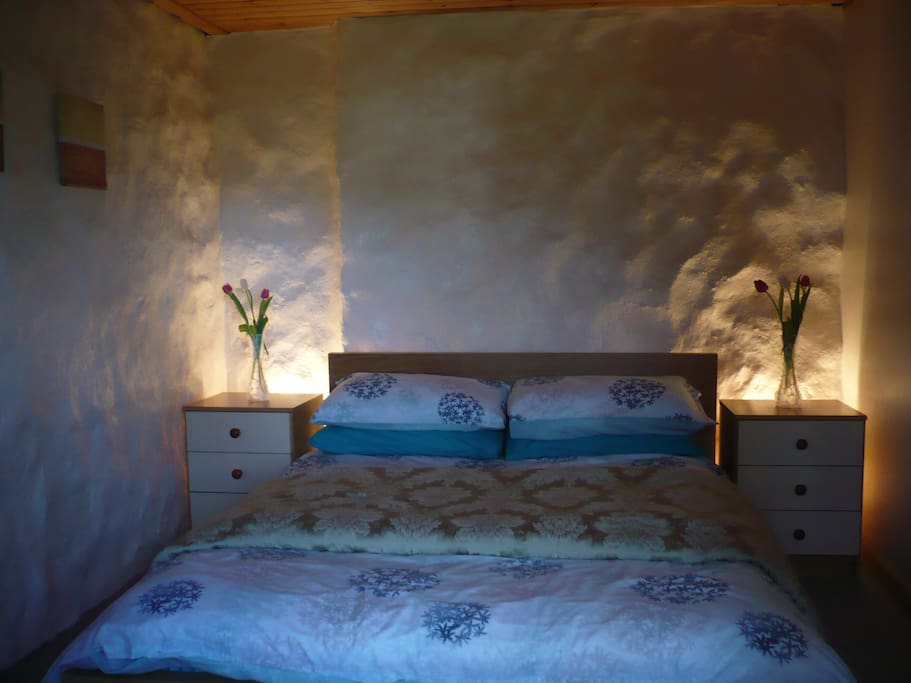 King size beds, traditional stone walls.