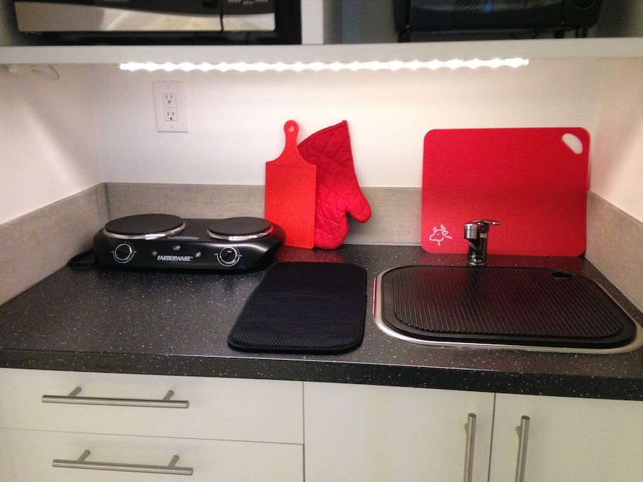 Kitchen has microwave, large fridge, toaster oven, coffee maker and all kitchen basics