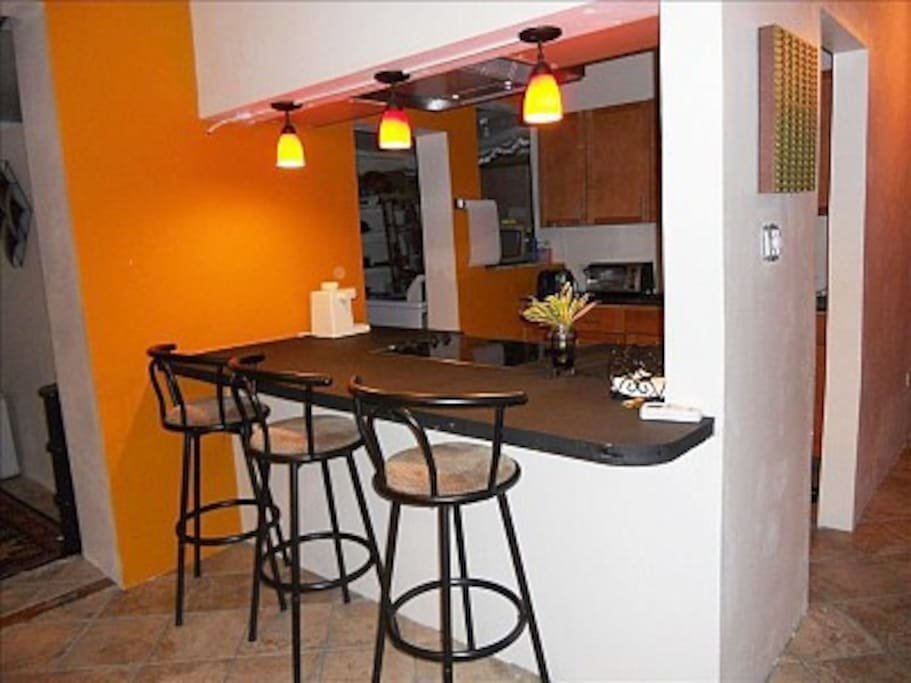 Breakfast bar, view to kitchen and laundry room