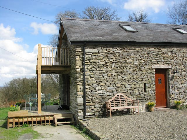 Yr Hen Beudy is a ground-floor apartment with decking for alfresco dining