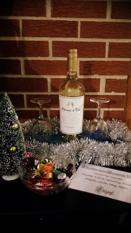 The holidays can be stressful - enjoy a complimentary bottle of wine and chocolates from around the world.