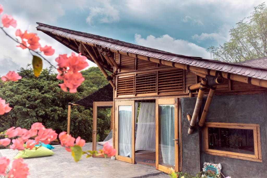 The shape of the roof reminds off the traditional batak houses from sumatra.