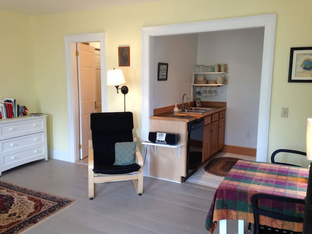 Dining nook, complete kitchen with dishwasher, reading chair, dresser.