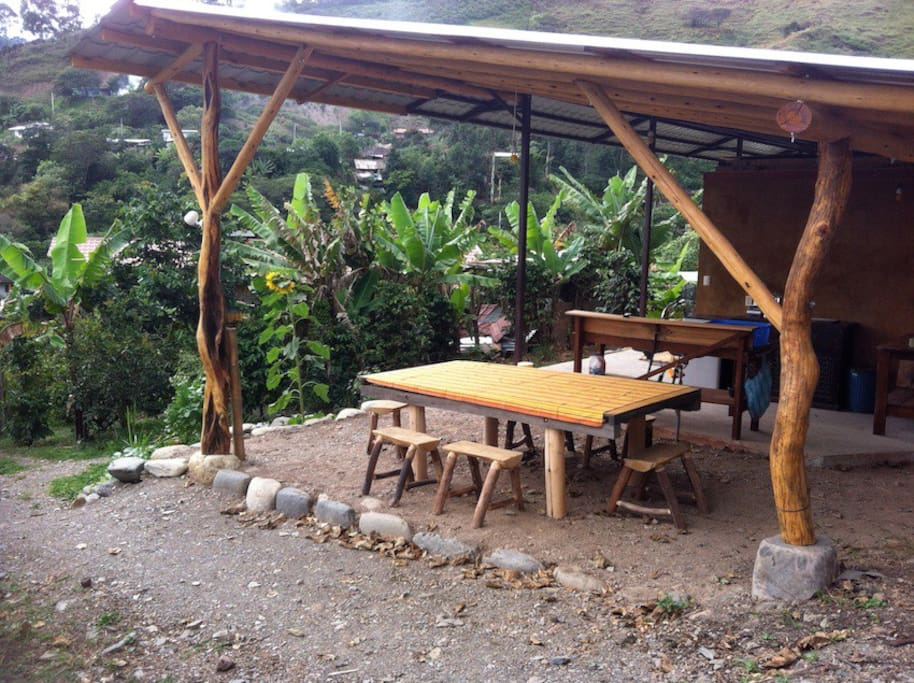 Mariposa open air kitchen and dining area surrounded by gardens and vistas
