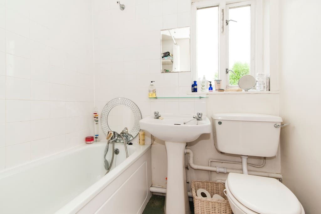 Bright and clean bathroom with shower and bath candles also available!