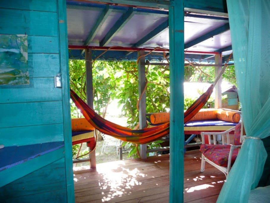 Beachfront Cottage: veranda with inviting hammock as viewed from bed