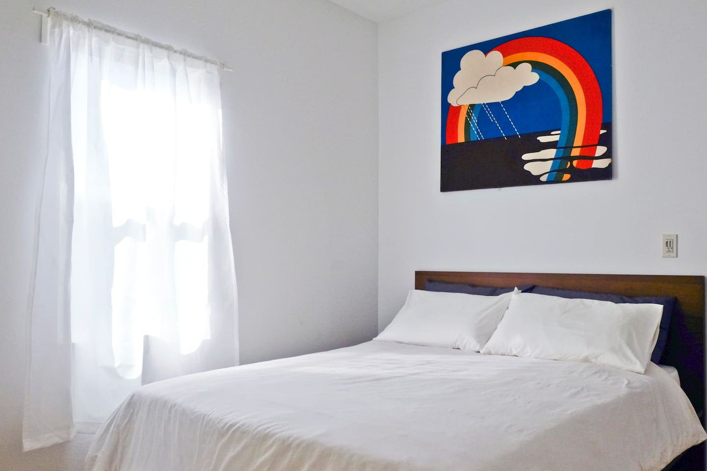 The queen size bed can accommodate up to 2 guests.  (What the bed looks like with white sheets. Please note that sheet colors may be different on check in. We have posted photos of other sheet colors in the photo gallery.)
