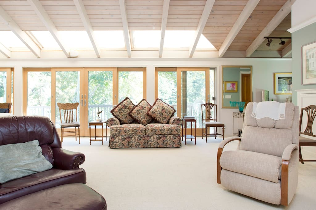 Living room focusing on wood sliding glass doors to south deck area