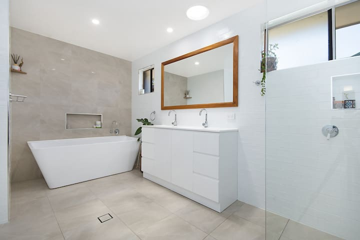 Newly renovated bathroom with large bath