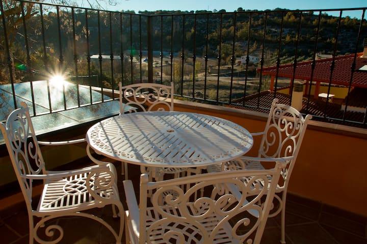 Estudio triple terraza, piscina climatizada - Hueva - Vakantiewoning