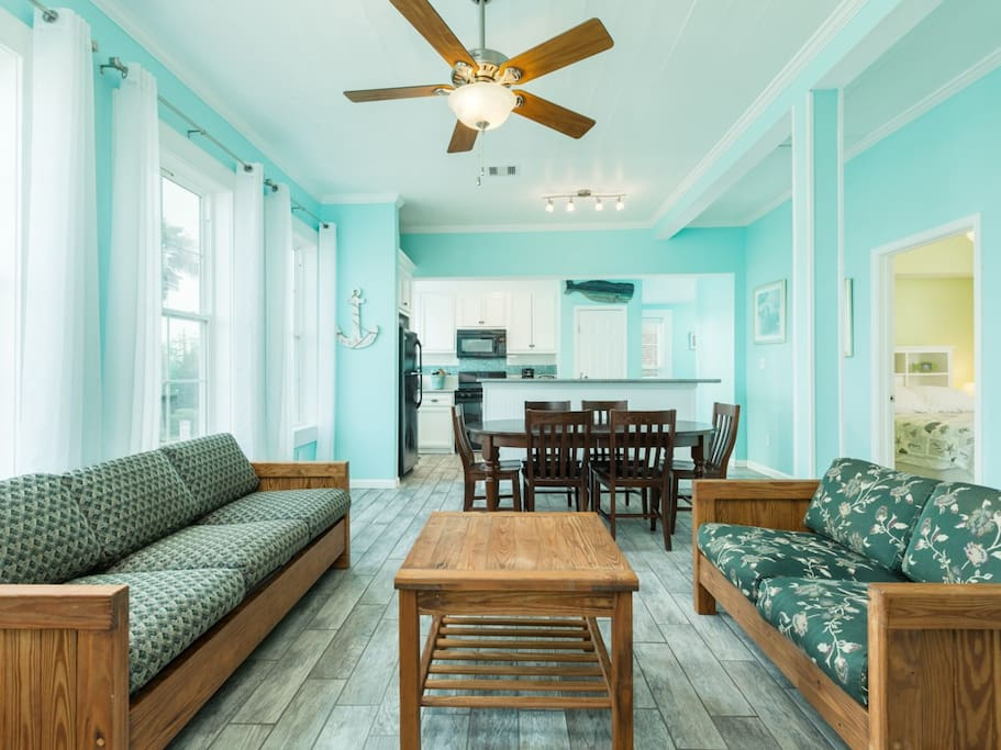 Natural light, ceiling fan and seating for everyone is available in the open dining and living area.