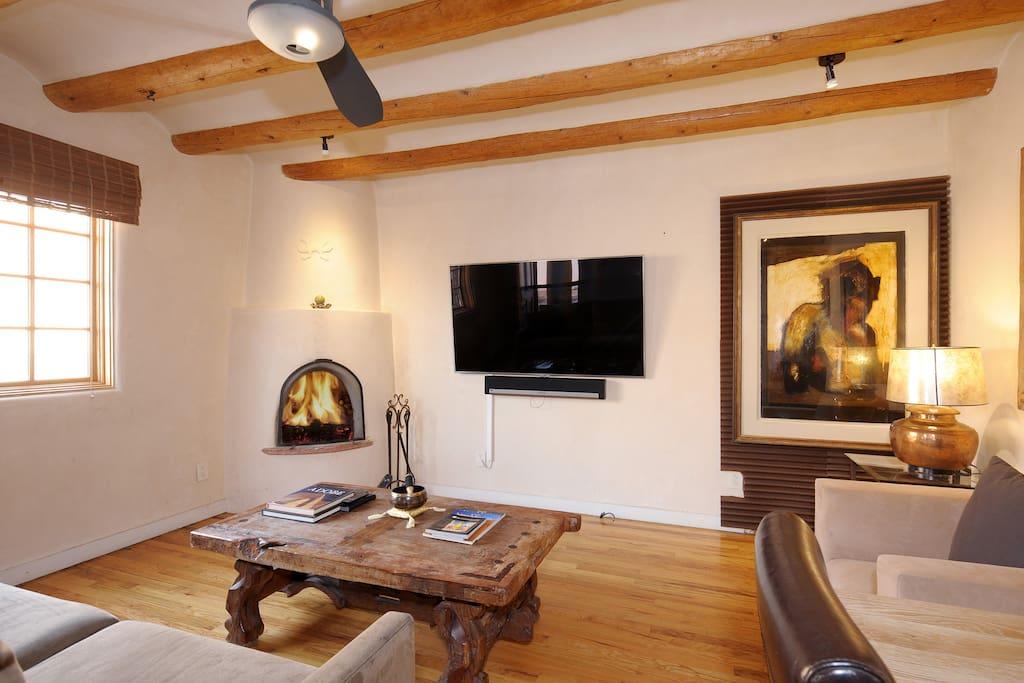 "Living Room w/ 65"" TV + Sonos  Speakers."