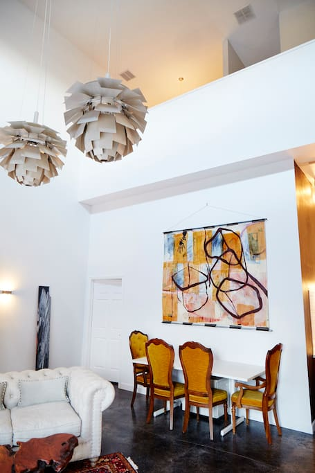 Dining area with a touch of art and vintage details.  Your private third floor overlooks this space.