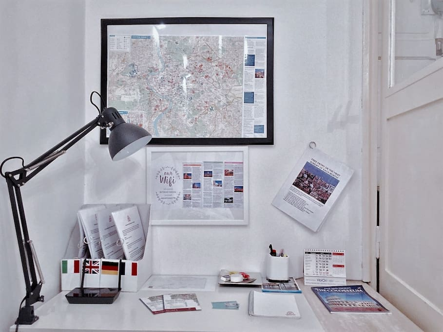 """Desk for work with Guides of the district in all languages, a large map of the city and other information.  """"The apartment was clean and had everything we needed (and was super cute and cozy!). The neighborhood is great and has lots of restaurants, grocery stores and public transportation very close by. We walked around a lot at all hours and felt very safe. It has a desk area set up with maps and information packets in different languages with descriptions of the neighborhood and businesses which were super helpful"""". Maria 5* / Jul 17"""