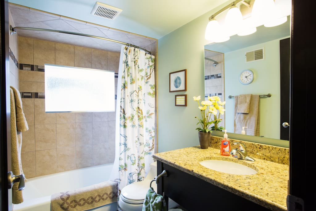 Private bathroom next door to Guestroom 1.  Includes shower & tub.  Remodeled summer 2013.