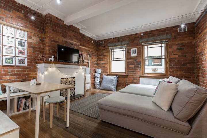 Perfectly positioned exposed red brick apartment