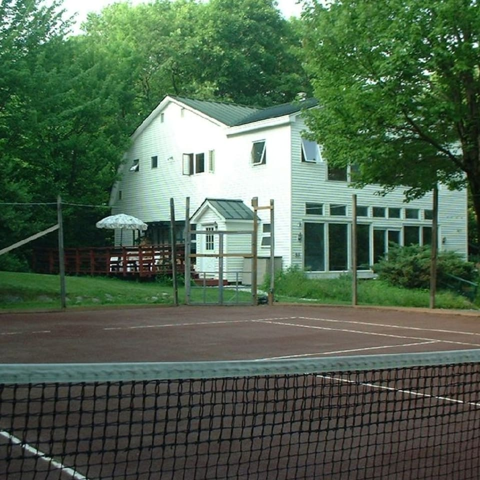 Quick drying red clay private tennis court