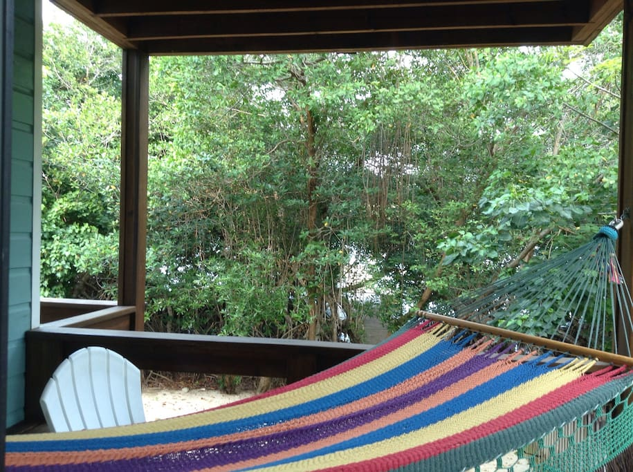 Your covered deck.  Hammock, Adirondacks and hummingbirds included!