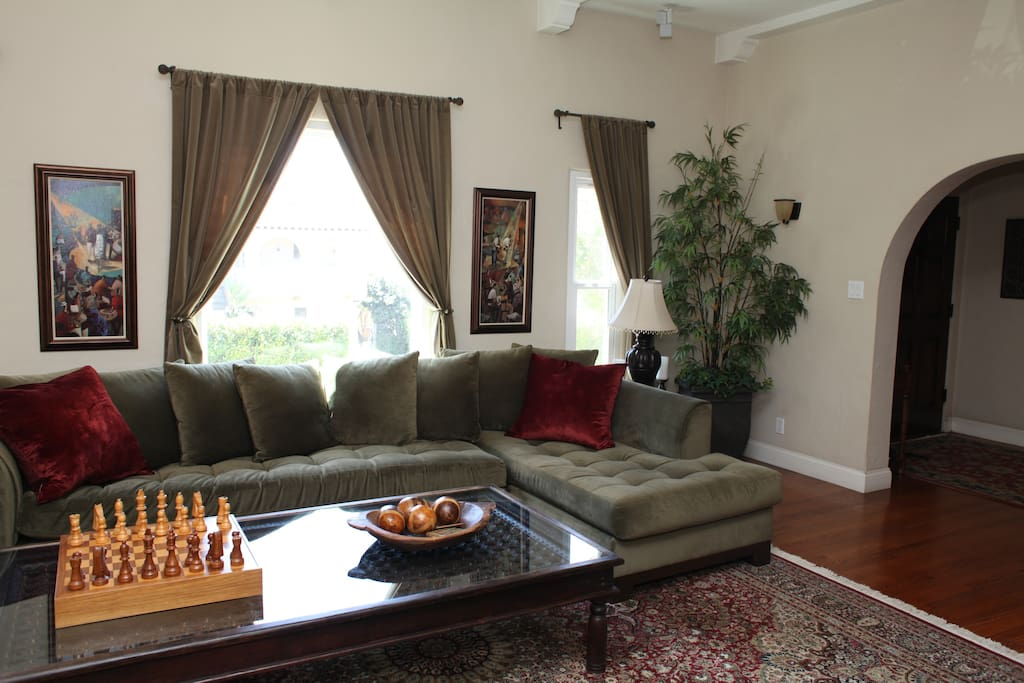 Large wrap around couch, beautiful/large glass table.
