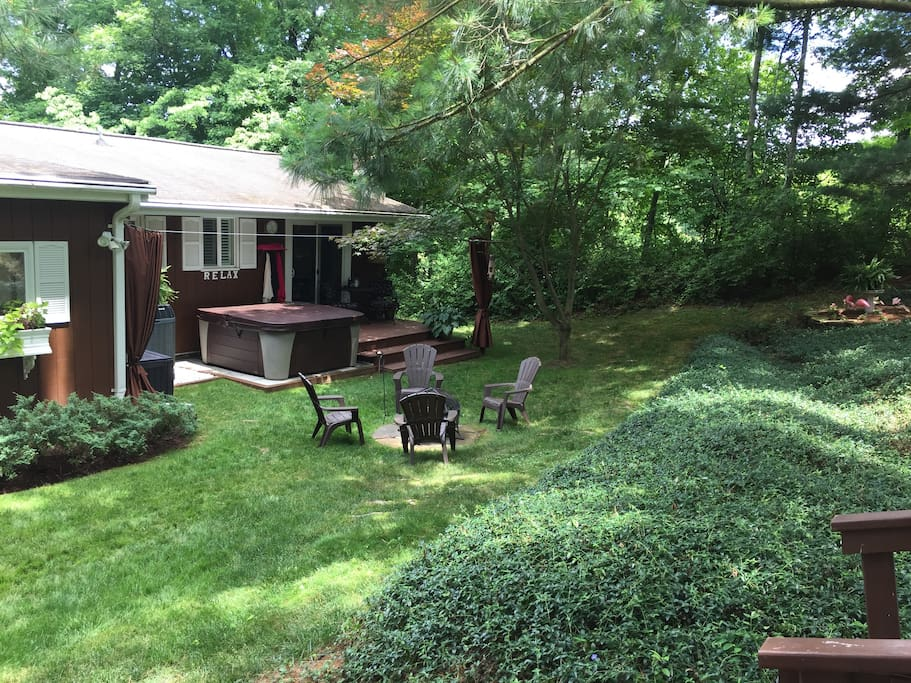 Back yard deck off bedroom 1. Fire pit . Surrounded by woods, very private and quiet