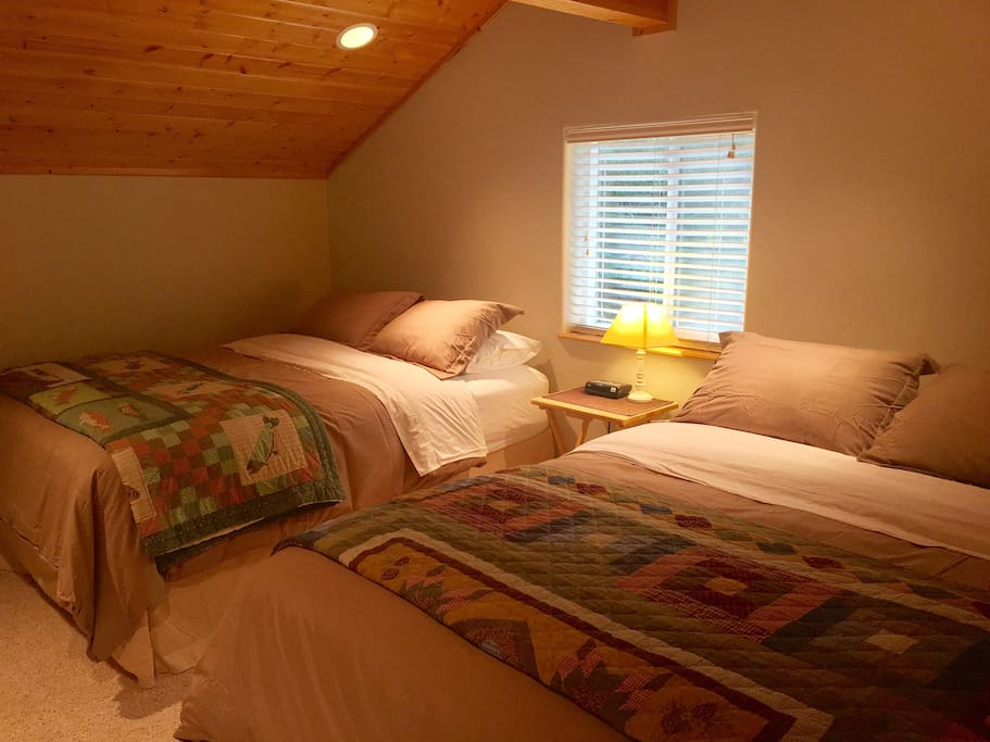 Two comfy queen size beds in loft