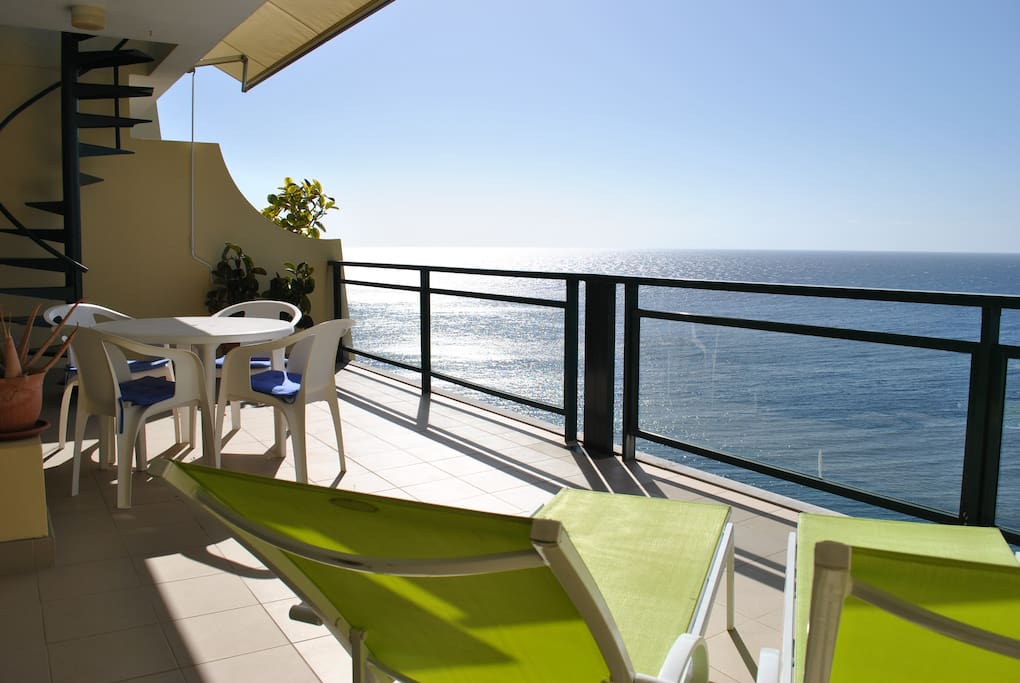 Relaxing at the terrace over the sea
