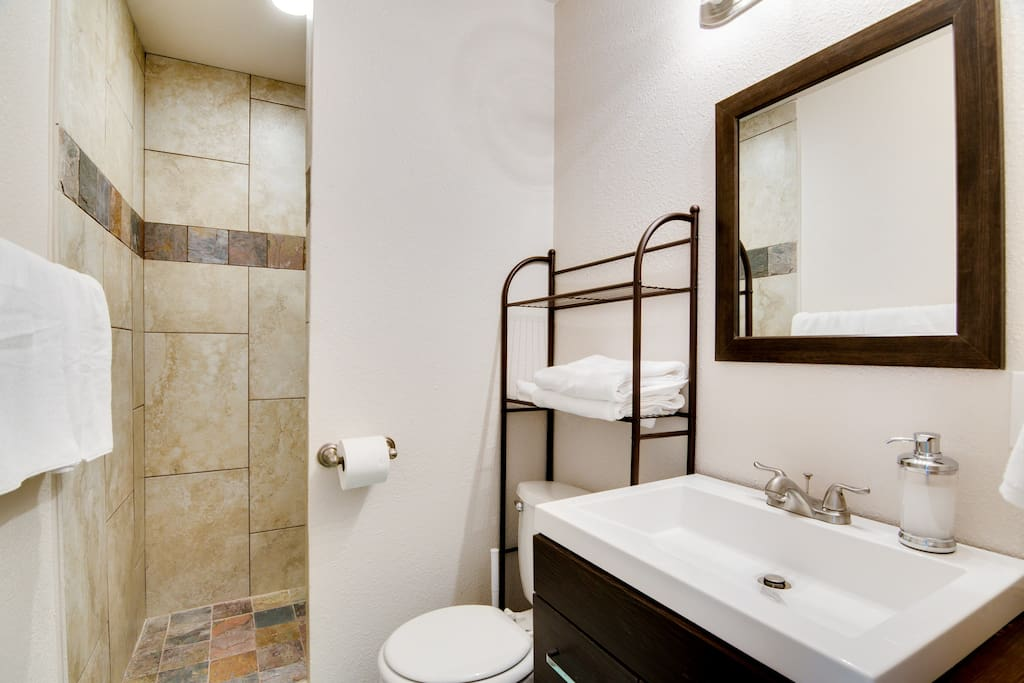 Slate tile bathroom.