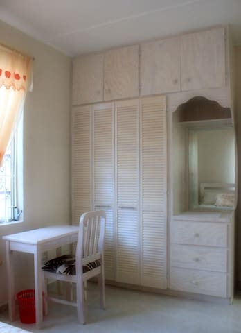 Built-in wardrobe and dressing table in bedrooms