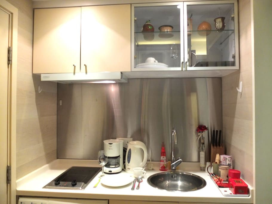 Happy Kitchen with high efficiency electric stove.  Kitchen utensils available.