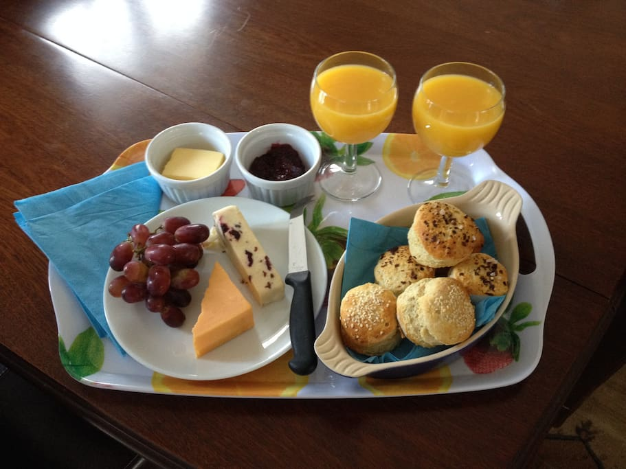 Breakfast tray with fresh home-made scones, preserves and juice etc.
