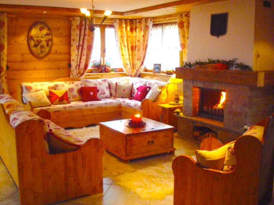 Lounge with log fire and comfortable seating and triple aspect