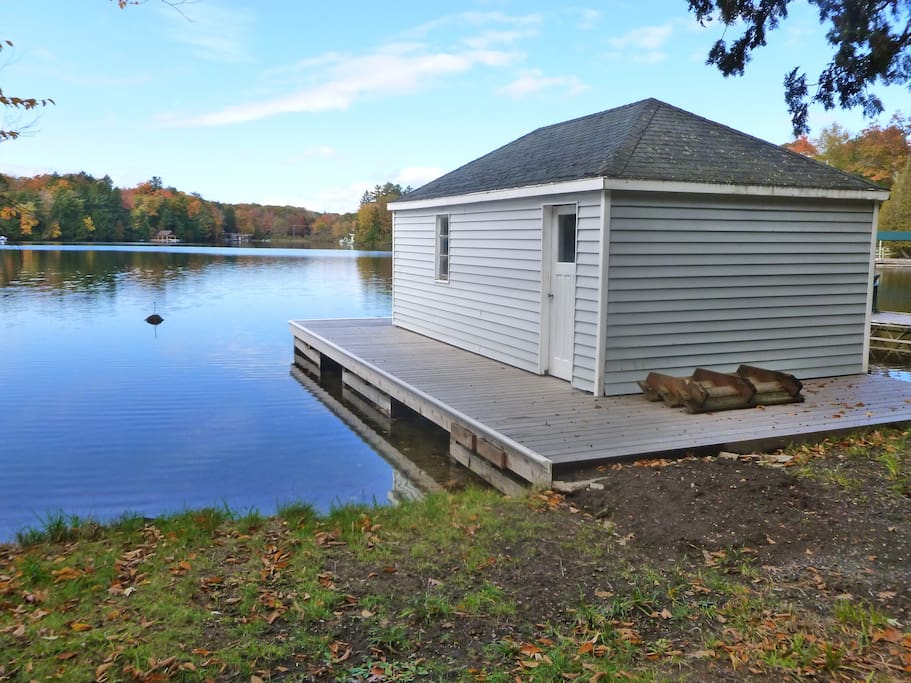 Shallow, walk-in access for swimming, sandy bottom, great for little kids. NEW boathouse 2014.