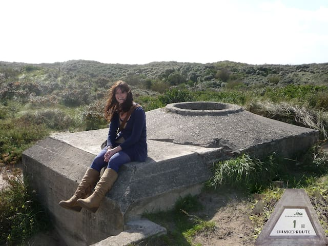 A - MUST DO - WALK leads you to the top of the highest dune at beach 'IJmuiderslag'. Here you can enjoy the most stunning views in all directions. Follow the path North; along the signed QR-codes 'Bunker route' (2.5km) which ends at the Bunker museum