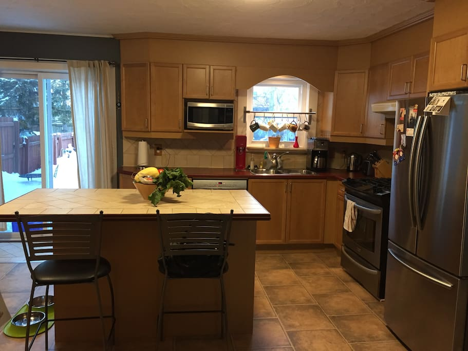 Large open kitchen with gas appliances & private yard with BBQ