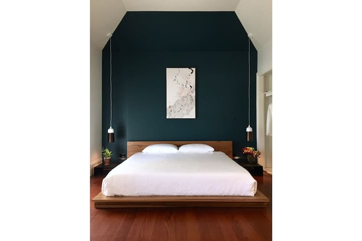 Japanese-inspired King platform bed - custom made, with luxury linen sheets.
